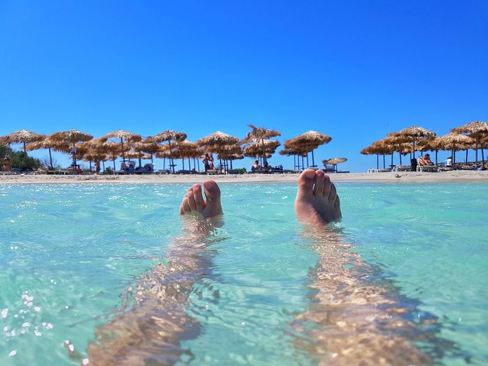 Sea Blue Water Beach Swimming People Day Clear Sky Outdoors Nature Adult Crete Greece Feets Feets In The Water