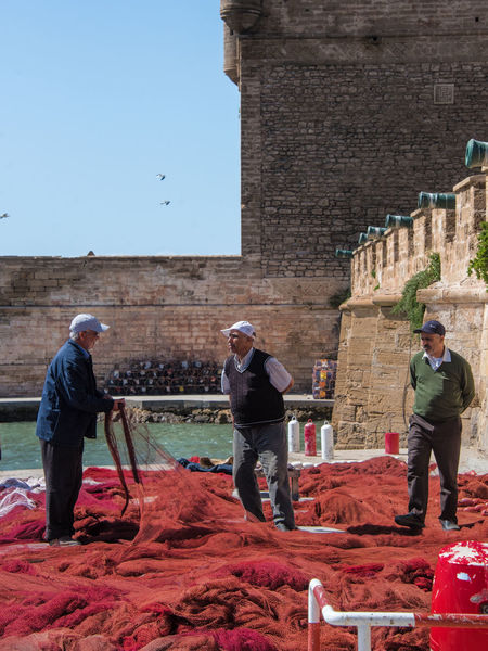 Harbor Worker Working Adult Architecture Building Exterior Built Structure Day Fisherman Fishernet Fortified Wall Full Length Group Of People History Males  Mature Adult Mature Men Men Nature Occupation People Real People Standing The Past Working