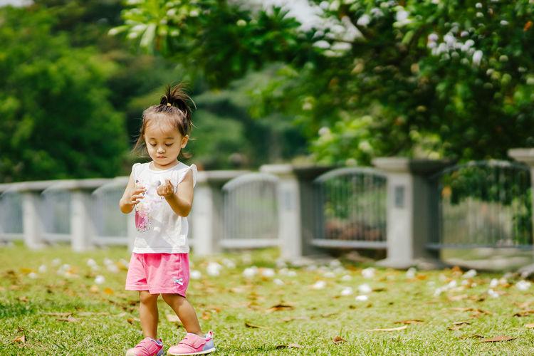 Full length of cute girl in grass