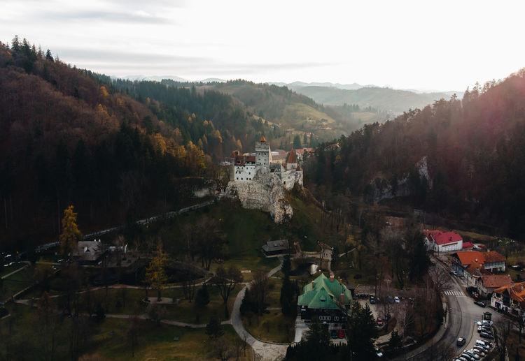 Bran castle on mountain against sky