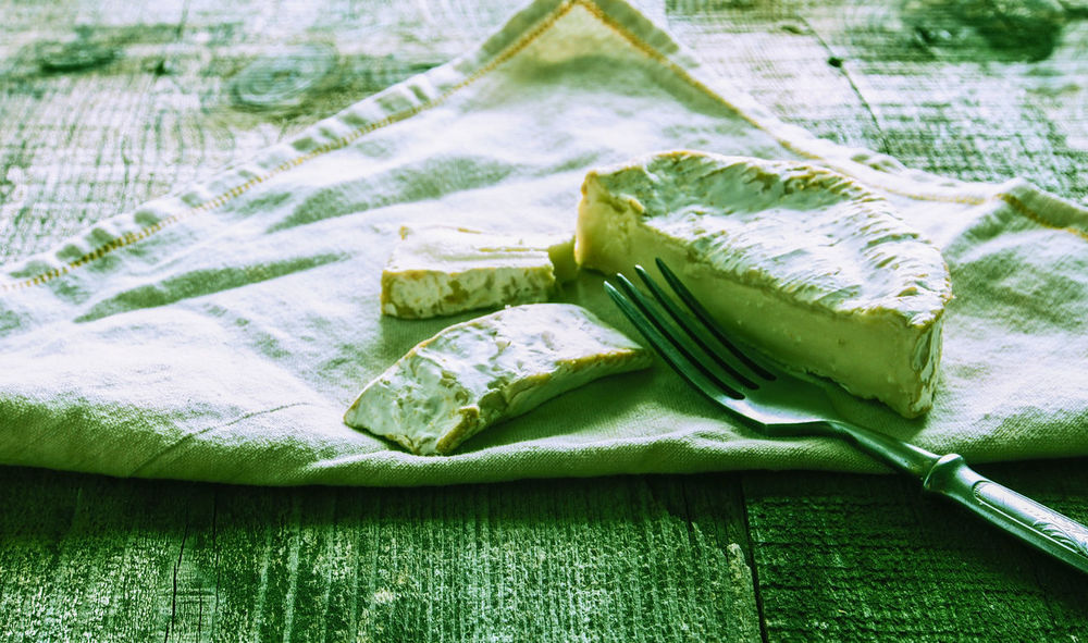 c with antique fork on cotton napkin on wooden background. Grunge style. Antique Camembert Cotton Crunge Fork Freshness Green Color High Angle View Napkin Nature Retro Sack Style Tranquility Tray Vintage