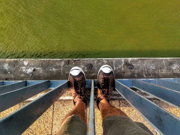 High Angle View Of Man By Water