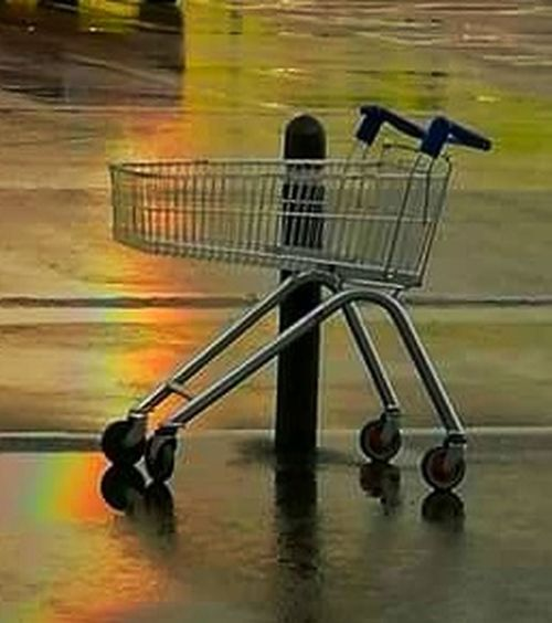 Rainbow Reflection Water Shopping Cart Reflection No People Puddle Indoors  Day Supermarket
