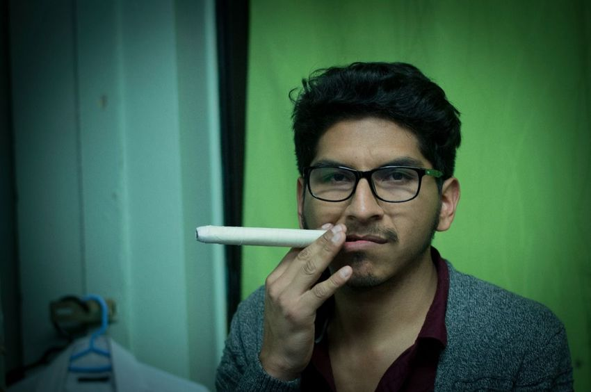 One Man Only Mid Adult Only Men Smoking - Activity Smoke - Physical Structure Adults Only One Person Eyeglasses  Black Hair Bad Habit Adult Portrait Headshot People Indoors  Addiction Looking At Camera Close-up Day