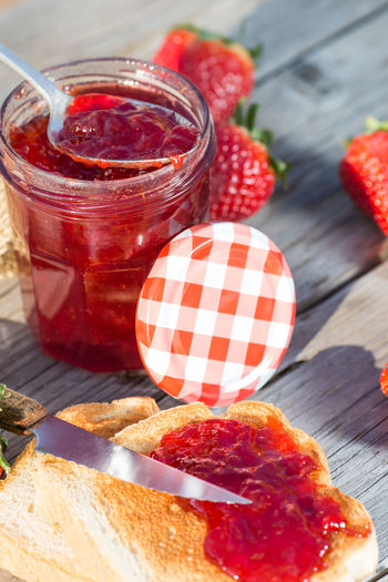 Berry Fruit Breakfast Close-up Container Eating Utensil Food Food And Drink Freshness Fruit Healthy Eating High Angle View Indoors  Jar No People Preserves Red Ripe Spoon Still Life Strawberry Strawberry Jam Table Temptation Wellbeing