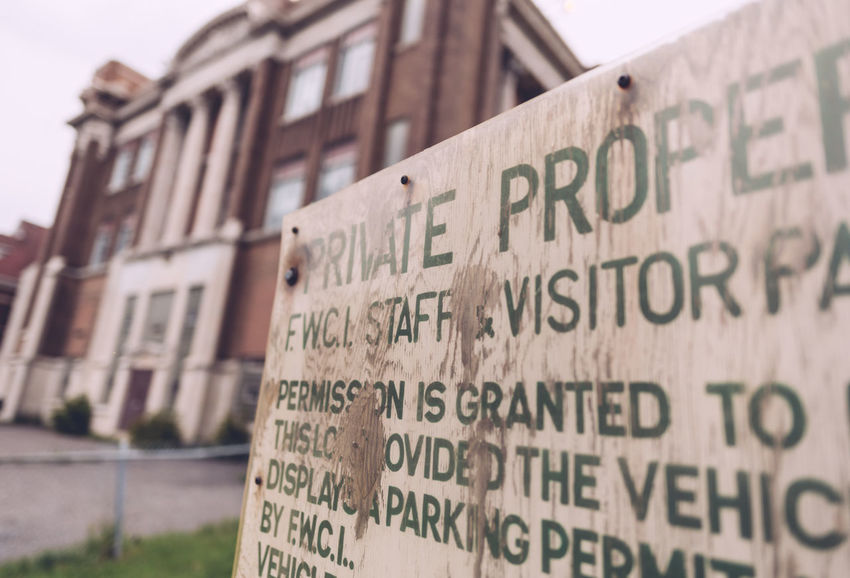 Private Property Sign Angled View Close Up Communication Old Buildings Old Sign Selective Focus Warning Warning Sign Western Script
