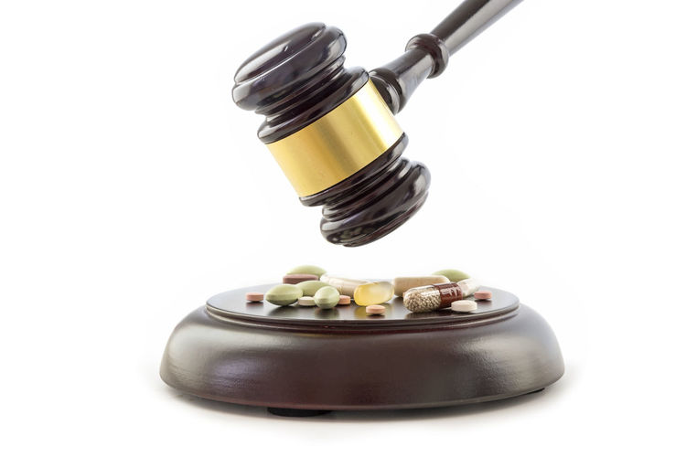 Beating  Court Crime Drunk Isolated Lawyer Nursing Pharmacy Pills Therapy Barbiturate Disease Doping Fraud Gavel Healthcare And Medicine Judge Medical No People Painkillers Pill Studio Shot Symbol Tablets White Background