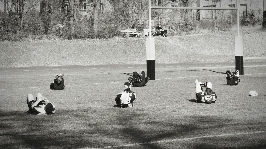 Sportsmen Warming Up On Field