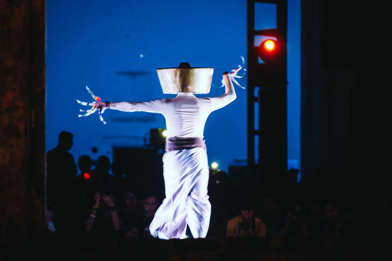 Rear View Of Dancer On Stage At Night