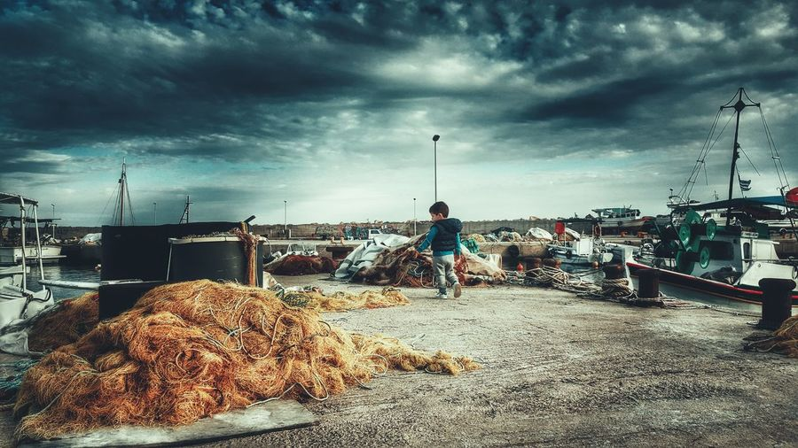 At The Port Port Life Little Boy Walking Around Exploring Exploring New Ground Sea And Sky Fishing Boats Fishing Port Low Angle View Low Angle Shot EyeEm Best Edits Taking Photos Hello World From Where I Stand From My Point Of View The Great Outdoors With Adobe