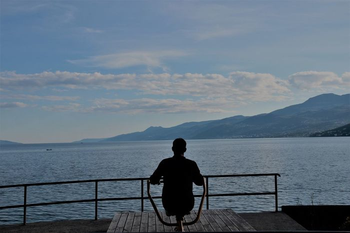 Beauty In Nature Cloud - Sky Day Men Mood Mountain Nature One Person Outdoors People Railing Real People Rear View Scenics Sea Silhouette Sitting Sky Standing Tranquil Scene Tranquility Water The Week On EyeEm Mix Yourself A Good Time Be. Ready.