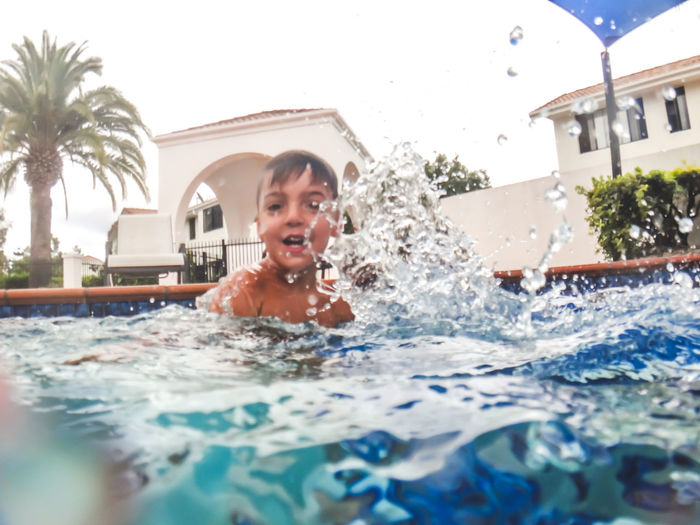 Portrait of smiling boy enjoying in swimming pool