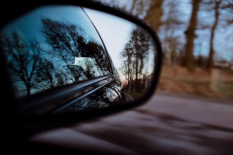WAY HOME Tree Reflection Land Vehicle Transportation Glass - Material Plant Mode Of Transportation Selective Focus Transparent Side-view Mirror Motor Vehicle Car No People Nature Day Sky Bare Tree Outdoors Close-up Vehicle Interior Vehicle Mirror