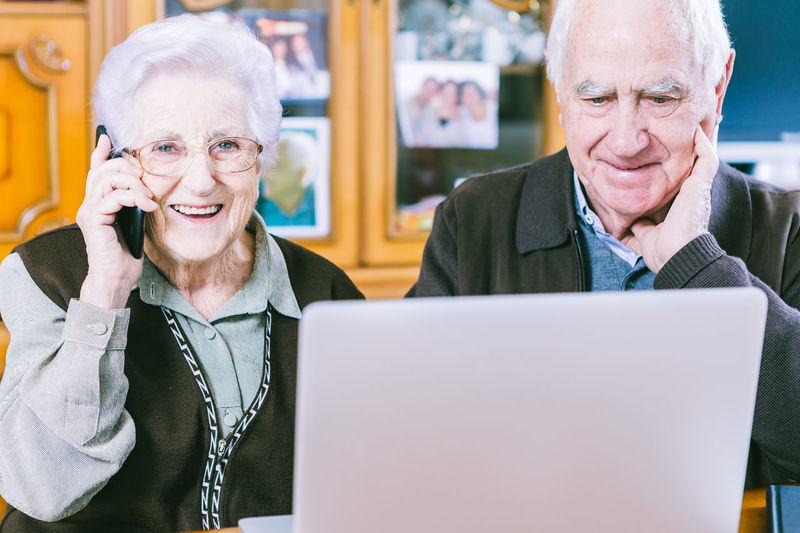 Portrait of smiling man sitting on laptop