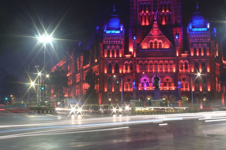 Mumbai Municipal Corporation heritage building decorated with colorful lights at night with light trails of moving traffic on the road Mumbai Herit Bmc Heritage Building Mumbai Municipal Corporation,India Light Trails Night Photography City Lights At Night Colorful Moving Traffic Blue Illuminated Night City Architecture Building Exterior Motion Built Structure Travel Destinations EyeEmNewHere
