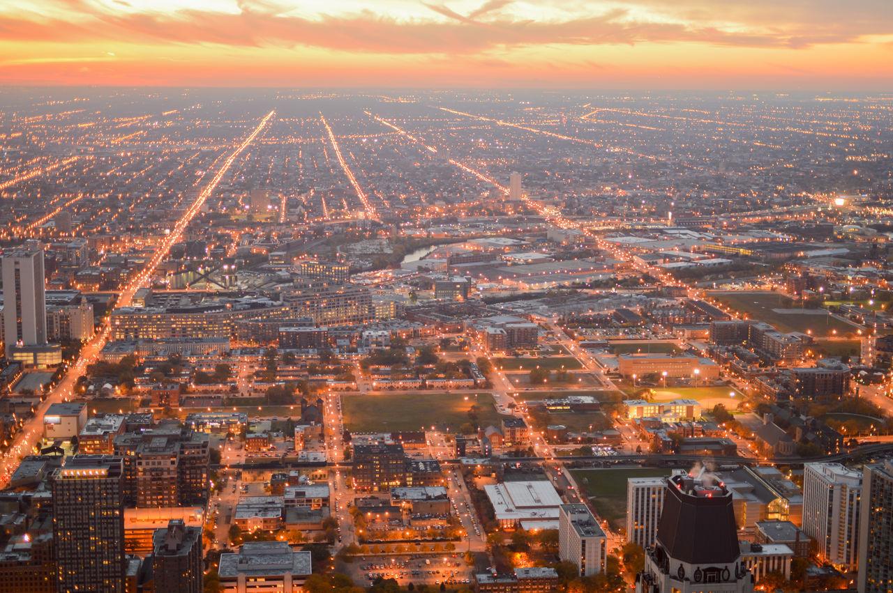 Aerial View Of Landscape Against Orange Sky