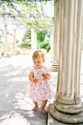 Full length of cute girl standing outdoors