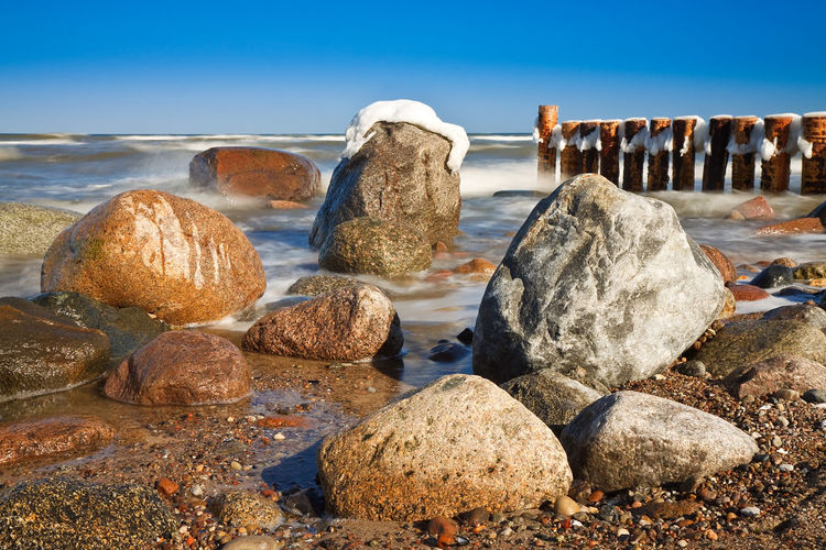 Rocks At Shore During Winter
