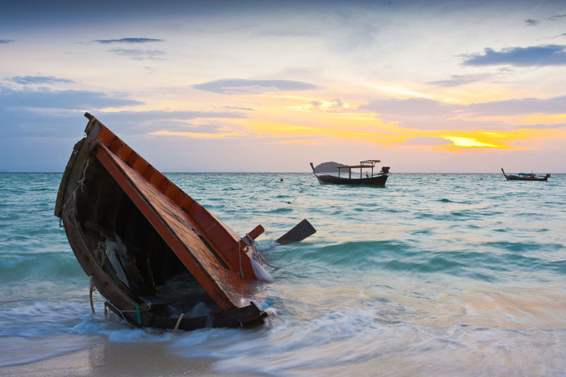 at Koh Lipe Thailand. Beach Beauty In Nature Boat Broken Fishing Boat Lipe Island Morning Light Sea Sky Sunset Thailand Travel Destinations Eyeem Market EyeEm Selects