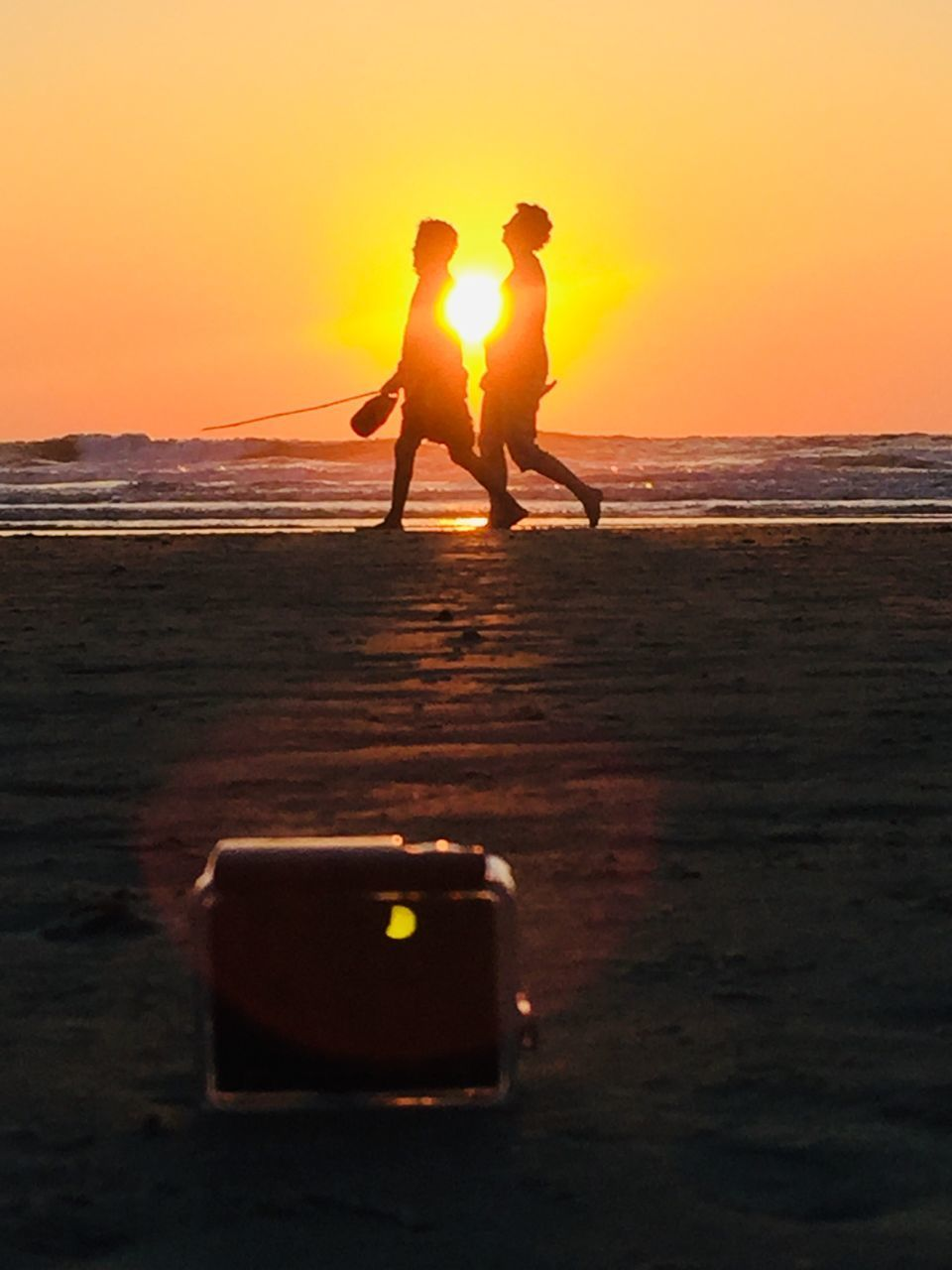 sunset, sky, orange color, sea, land, two people, beach, men, real people, water, beauty in nature, togetherness, lifestyles, nature, standing, leisure activity, silhouette, women, scenics - nature, horizon over water, outdoors, positive emotion
