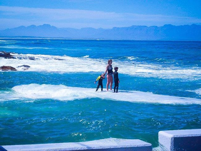 I took this picture a few years ago. This mom and her two kids were in a tidal pool. Although it looks like they are standing on water, they are in fact standing on a rock in the pool that is painted white. Sunny Days . ☀ Beach Photography EyeEm Nature Lover
