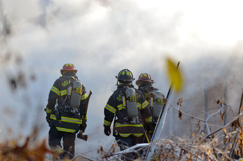 Rear view of rescue workers