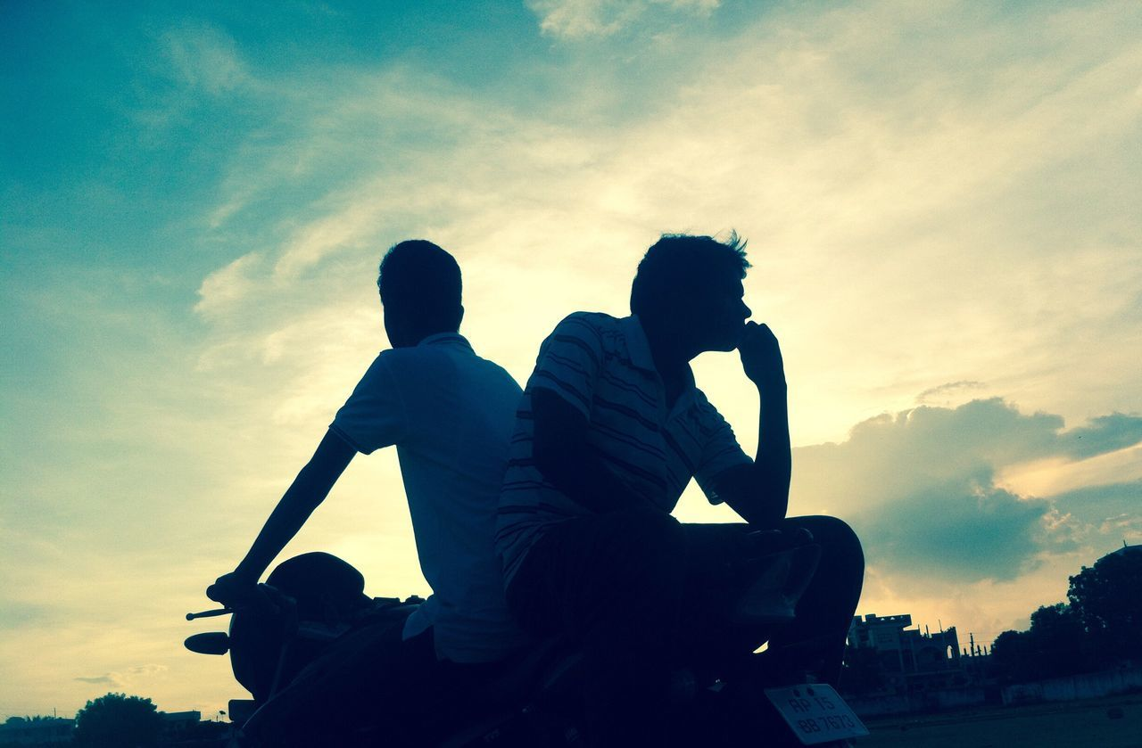 two people, sky, cloud - sky, sunset, togetherness, sitting, silhouette, men, low angle view, real people, friendship, leisure activity, love, boys, outdoors, lifestyles, bonding, full length, childhood, nature, day, adult, people
