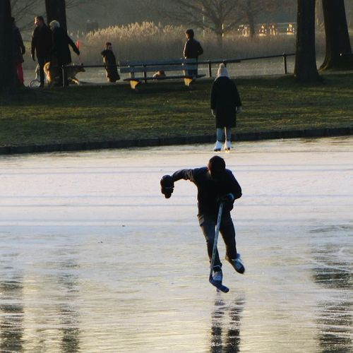 Fun On The Ice Ice Hockey Ice Skating Fast Sport Sport Leisure Activity Action Photo Frozen Lake Park Warande Helmond Wintertime Trees People Outdoors Ice Sports Grass Reflections Afternoon Sun Sunshine Winter Sports