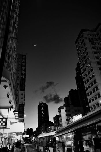 City street and buildings against sky