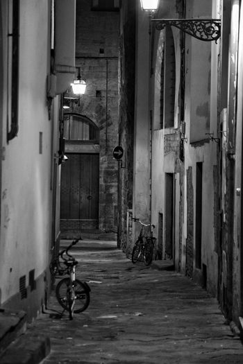 Florence Street By Night Street Photography Florence Florence Italy The Best City In The World Monochrome Black And White Shadows Shadows & Light Travel Contrast Casting A Shadow Outdoors Bicycle No People Mystery Street City Winter Shadow Illumination Building Exterior Architecture Illuminated Night Mysterious Place