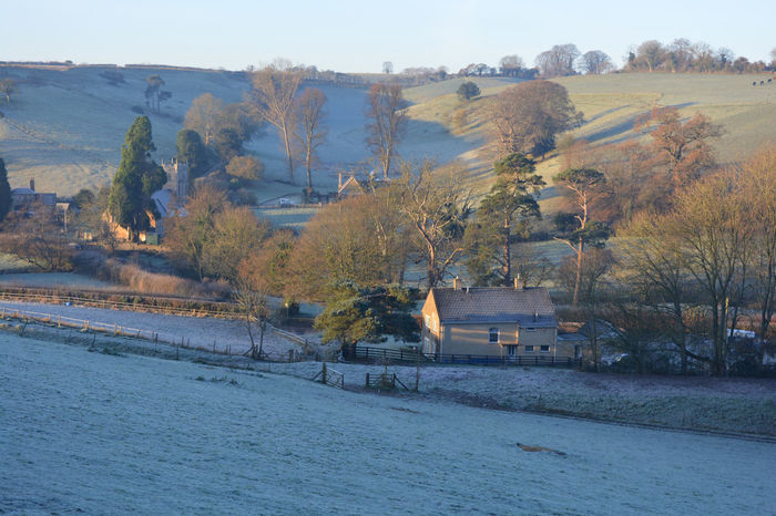 Early morning view after a heavy frost towards the hamlet of Pitcombe, near Bruton. Architecture Beauty In Nature Building Exterior Built Structure Cold Temperature Day Farmland Frost Frosty Morning Hills Ice Nature No People Outdoors Picturesque Pitcombe Rural Lanscape Sky Tree Winter Winter Landscape Shades Of Winter