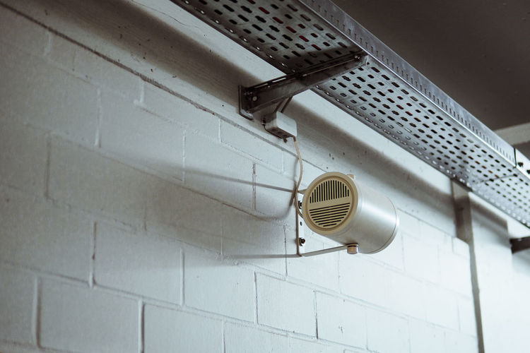 Low angle view of speaker mounted on wall