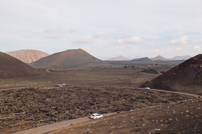 Canary Islands Cars Lanzarote Road SPAIN Travel Volcanoes Arid Landscape Day Geological Formation Island Landscape Mountain Range Volcanic  Volcano