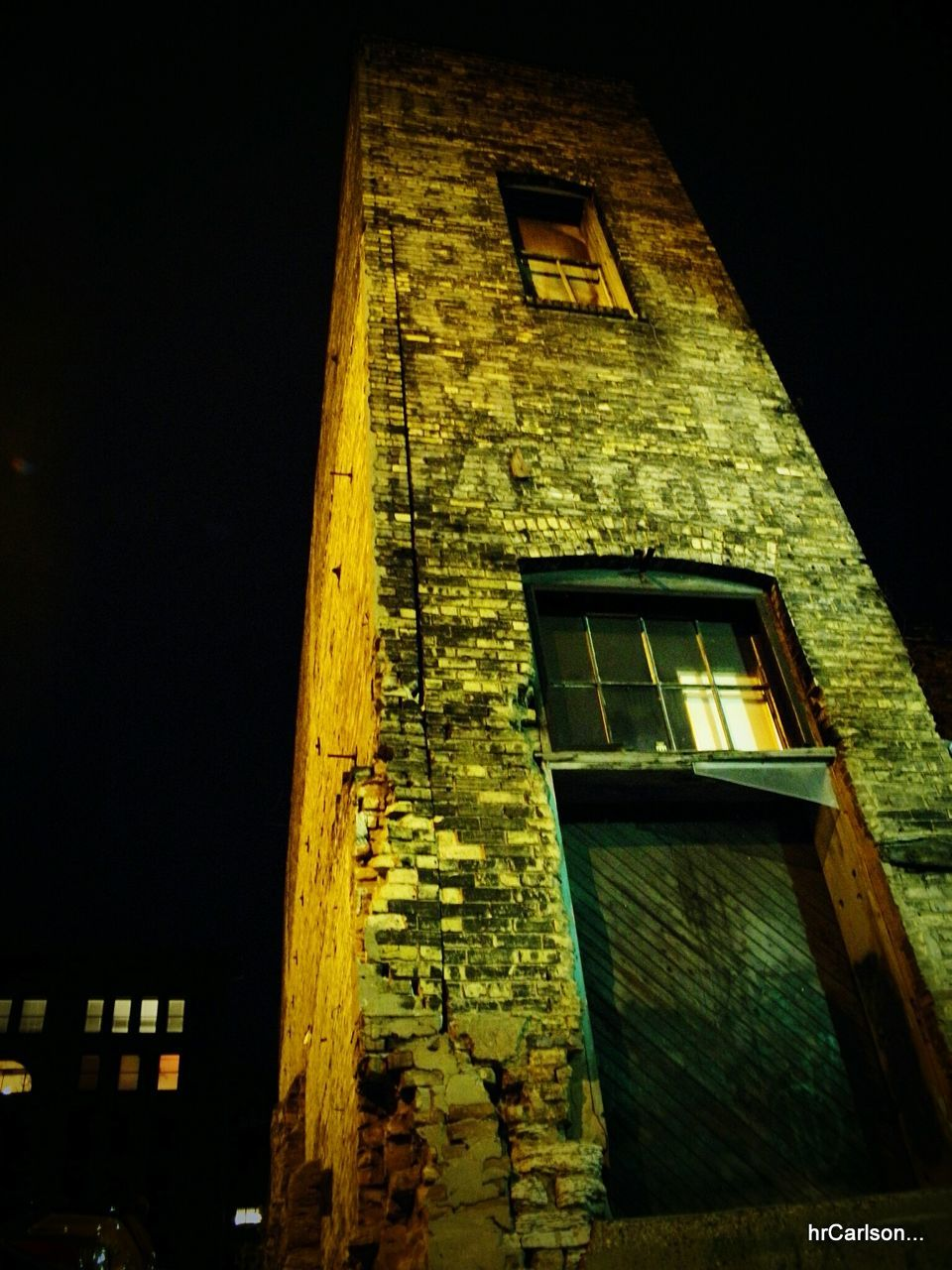 building exterior, architecture, built structure, window, low angle view, no people, outdoors, night, illuminated, sky