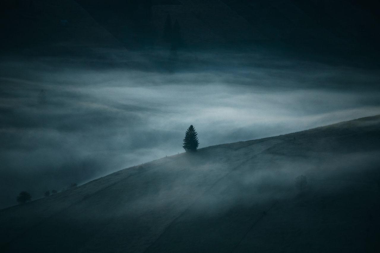Mountain against cloudy sky