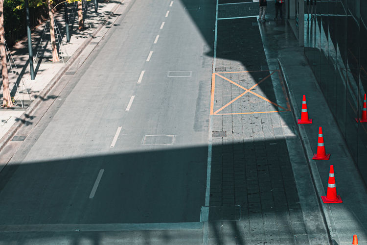High angle view of arrow symbol on road in city