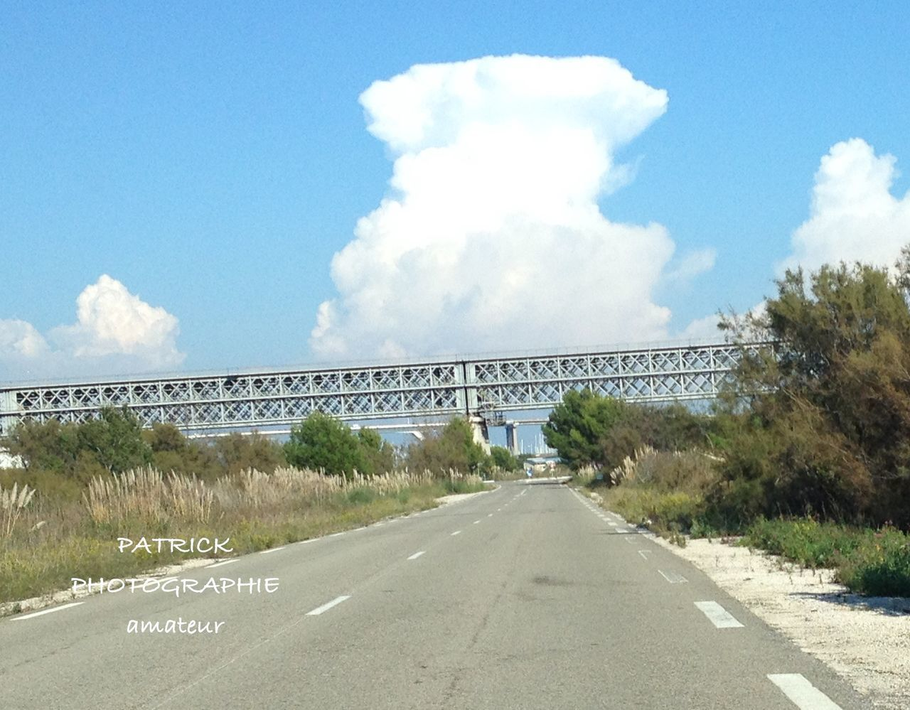 sky, cloud - sky, road, the way forward, day, no people, built structure, architecture, transportation, outdoors, nature, tree