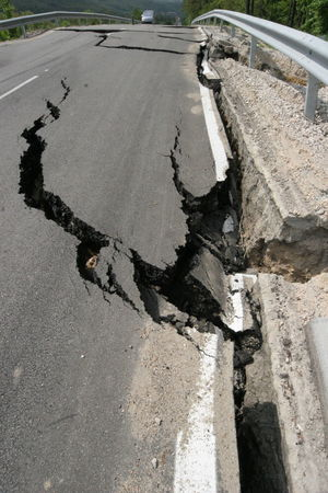 Road collapses with huge cracks. International road collapsed down after bad construction. Damaged Highway Road. Asphalt road collapsed and fallen. Erosion. Asphalt Collapse Cracks Road Bad Bad Construction Collapsed Collapsed Road Construction Industry Crack Earthquake Erosion Erosion Control Erosion Effects Low Construction