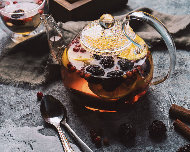 fruit and berry herbal tea in glass teapot Homemade Cinnamon Hot High Angle View Sweet Food Black Tea Afternoon Tea Tea Beverage Tea Cup Herbal Tea Kettle