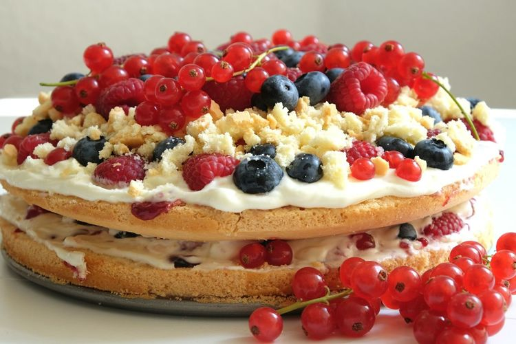 Close-Up Of Fruits On Cake Layers