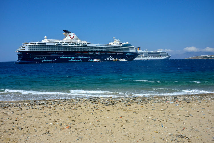 seascape with cruise ships anchored in Mykonos Water Sea Nautical Vessel Beach Sky Mode Of Transportation Land Transportation Ship Day Nature Motion Travel Wave Sand No People Built Structure Architecture Travel Destinations Cruise Ship Outdoors Passenger Craft Costa Deliziosa Mein Shiff Seascape Cruise Cruising Moored Ships Costa Crociere Mykonos,Greece Waves