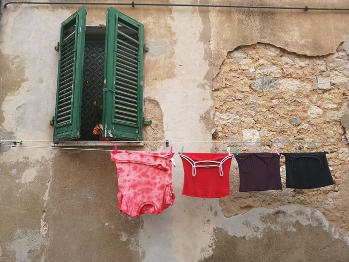 Clothes drying against wall of old building