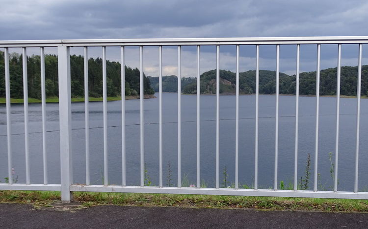 Talsperre hinter Gitter Drinking Water Railing Wahnbachtalsperre Beauty In Nature Cloud - Sky Day Drinking Water Reservoir Growth Nature No People Outdoors Reservoir Reservoir View Sky Technology Tree