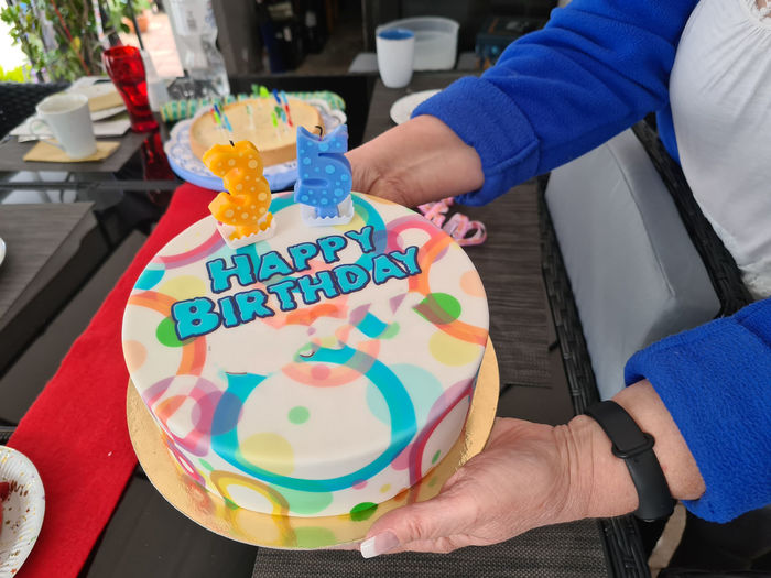 Midsection of person holding cake