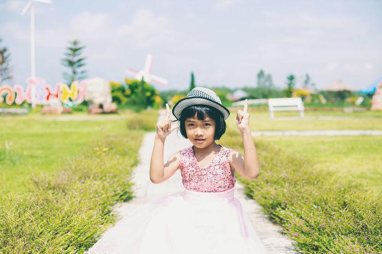 Full length of cute girl standing on field