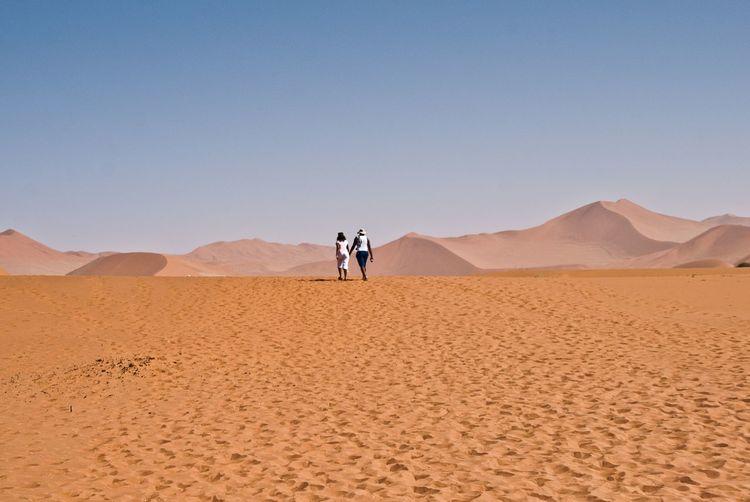Tourists on sand dune