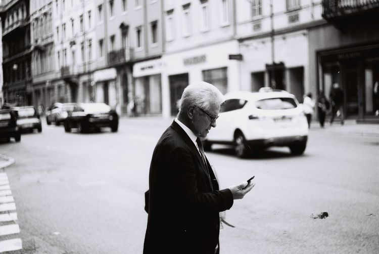 Callingher City Life City Street Crossroad Day Italianeography Italy Lifestyles Men One Person Only Men Outdoors People Real People Senior Adult Senior Men Street Streetphotography Trieste