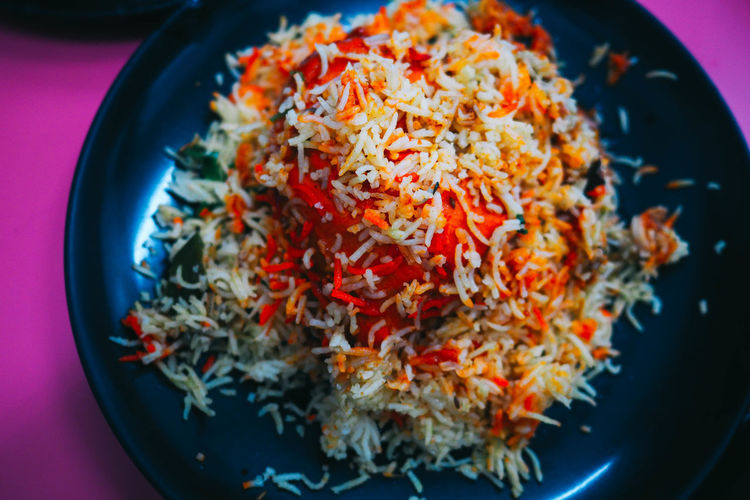 Close-up high angle view of fried rice in plate on table
