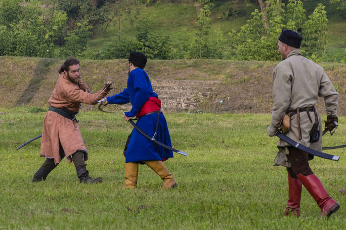 Historical Reconstruction Historical Reenactment Reconstruction Group Battle Fencing Group Of People Leisure Activity Outdoors People Saber Weapon