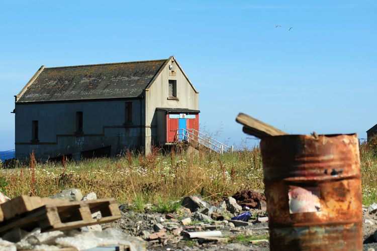 Abandoned Architecture Birds Blue Building Exterior Built Structure Clear Sky Damaged Day Derelict Derelict & Abandoned Derelict Building Deterioration First Eyeem Photo Lifeboat No People Obsolete Outdoors Run-down She Shed